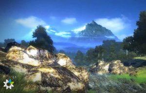 горы вдали каменные утесы зеленая трава